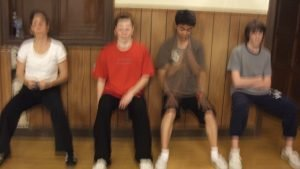 Wushu athletes doing wall sits